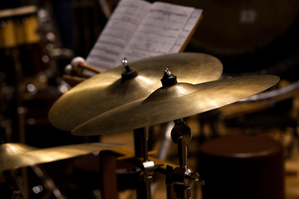 Orchestral cymbals closeup in dark colors